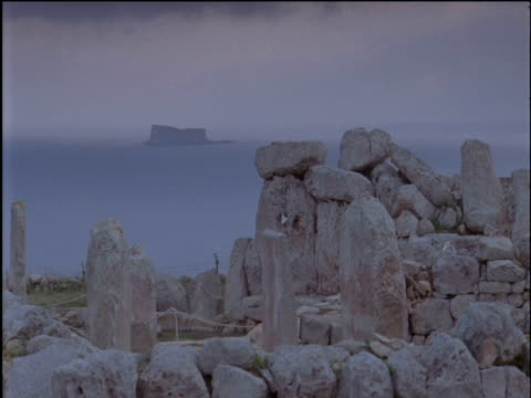 ruins at stone temple mnajdra malta - temple building stock videos & royalty-free footage