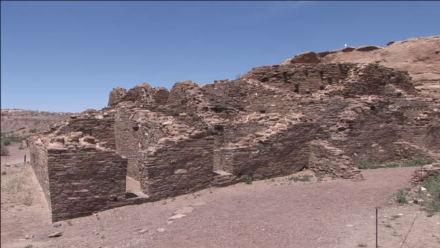 ruins in chaco culture national historical park blend in with the arid surroundings. - chaco culture national historical park stock videos & royalty-free footage
