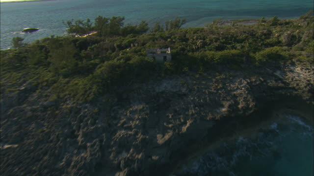 AERIAL ZO Ruins of abandoned home on rocky island near Nassau, Bahamas