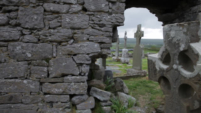 ws pan ruins of ancient cemetery / ireland - stone wall stock videos and b-roll footage