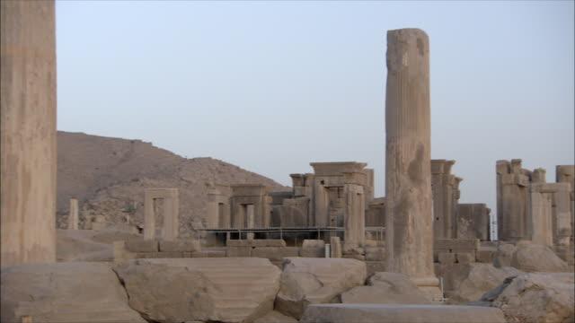 ws pan ruins of ancient city, throne room, persepolis, iran - stone wall stock videos & royalty-free footage