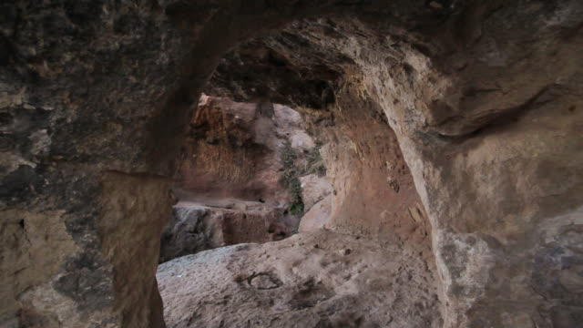 w/s ruins of ancient eremites cave dwellings - cliff dwelling stock videos & royalty-free footage