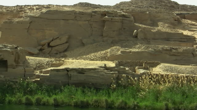 ms, pan, ruins of ancient quarries along nile river, egypt - quarry stock videos and b-roll footage