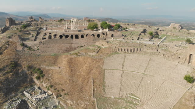 ruins of ancient temple of trajan and amphitheatre in acropolis of bergama, turkey - amphitheatre stock videos & royalty-free footage