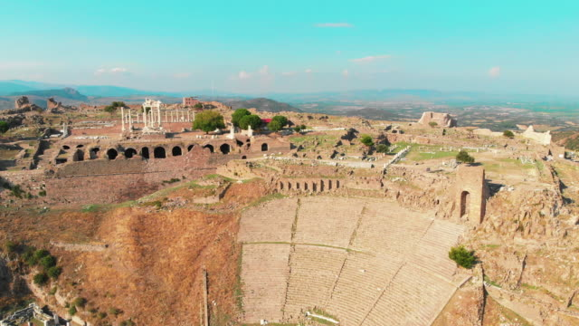 ruins of ancient temple of trajan and amphitheatre in acropolis of bergama - temple building stock videos & royalty-free footage