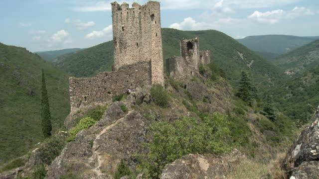vidéos et rushes de ws ruins of chateaux de lastours in mountain landscape / lastours, france - xiiième siècle