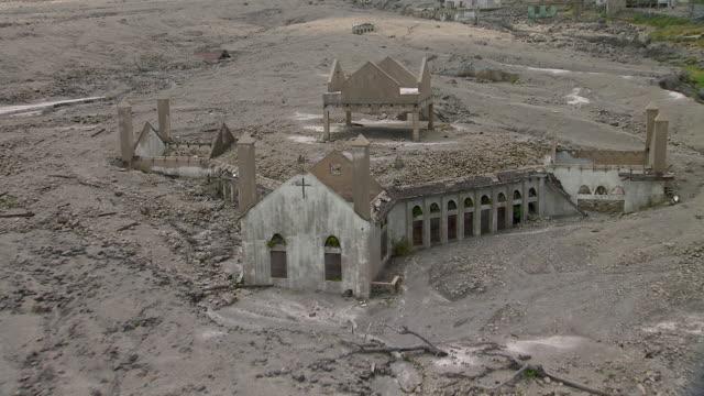 ruins of church surrounded by lava flow on montserrat island. - pyroklastischer strom stock-videos und b-roll-filmmaterial