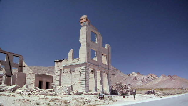 WS PAN Ruins of Cook Bank building, Ghost Town of deserted Goldmine Town of Rhyolite, Nevada, USA