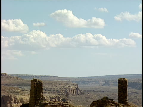 ruins of penasco blanco in chaco canyon are scattered in the desert. - chaco canyon stock videos & royalty-free footage