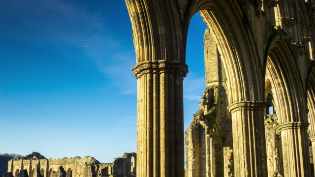 ruins of rievaulx - motion timelapse - abbey monastery stock videos & royalty-free footage