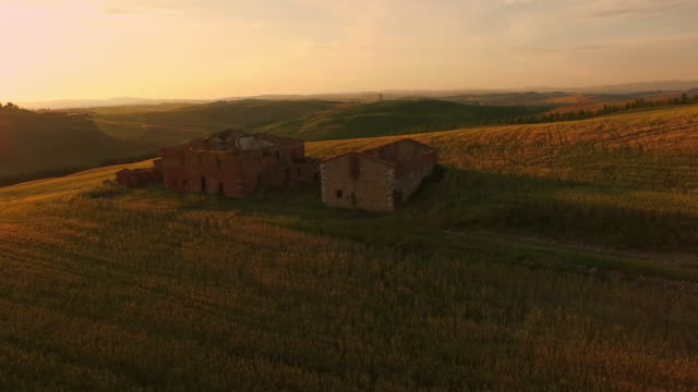 AERIAL Ruins on top of a hill at sunset