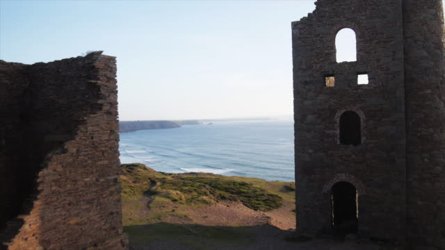 ruins on uk cliffside, aerial - cornwall england stock videos & royalty-free footage