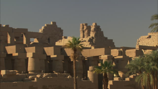 ruins still stand in the ancient city of karnak, egypt. - temples of karnak stock videos & royalty-free footage
