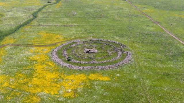 "rujm el-hiri megalithic monument ,often referred to as the ""stonehenge of the levant /aerial golan heights - archaeology stock videos & royalty-free footage"