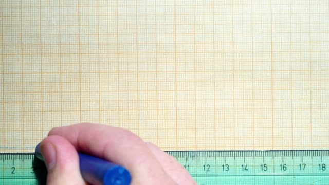 ruler and crayon on graph paper - ruler stock videos & royalty-free footage