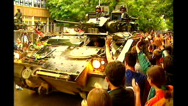ICJ rules 2008 Kosovo state declaration does not violate international law T18069901 Kosovo EXT People lining street to welcome NATO troops TRACK...