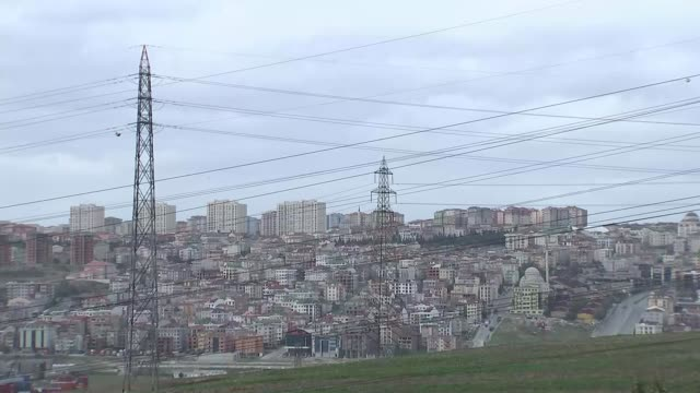 ruling ak party wins resounding victory in general election various of concrete tower blocks on skyline of istanbul outskirts/ construction worker on... - cantiere di costruzione video stock e b–roll