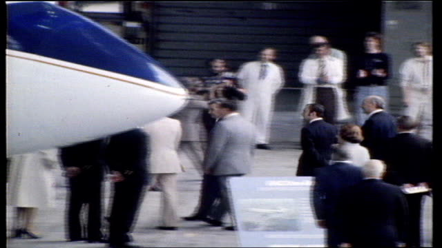 Filton Ceaucescu and wife PULL OUT CMS Both Ms Agreement signed MS Ceaucescu shakes hands MS Sign 'BAC 111' TILT plane MS Party walk in hangar MS...