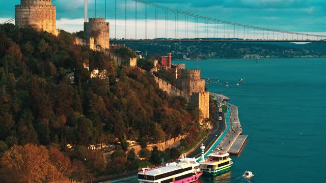rumeli fortress and fatih sultan mehmet bridge on istanbul bosphorus aerial drone footage - istanbul /4k - istanbul stock videos & royalty-free footage