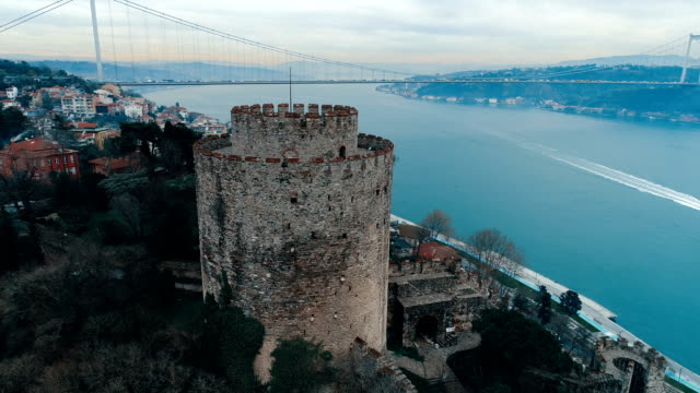 rumelihisarı fortress and the bosphorus bridge - istanbul  aerial view - straits stock videos and b-roll footage