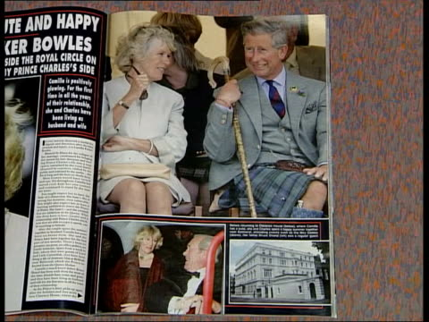 vidéos et rushes de rumours of feud between camilla and sir michael peat; int copy of 'hello' magazine as opened to story on camilla parker bowles detail of article and... - bavardage