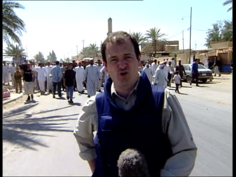 stockvideo's en b-roll-footage met rumsfeld visit/shooting incident itn men carrying coffin of shooting victim along track i/c ms coffin carried along - al fallujah