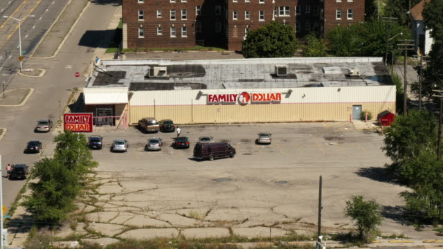 run down family dollar store in the outskirts detroit. view from above.  wide shot - spoonfilm stock-videos und b-roll-filmmaterial