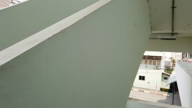 run down the stairs, fire escape.human eye view - office doorway stock videos & royalty-free footage