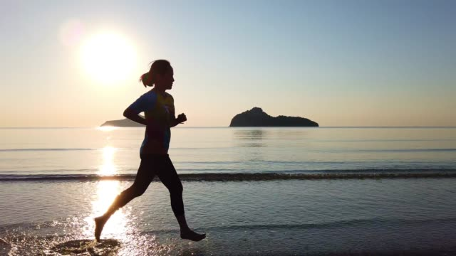 run for new life - triathlon stock videos & royalty-free footage