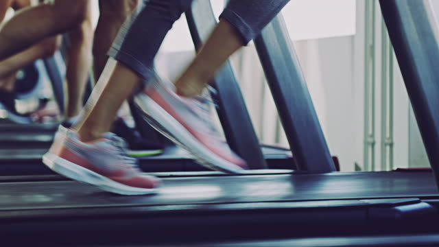 run towards your fitness goals - treadmill stock videos & royalty-free footage