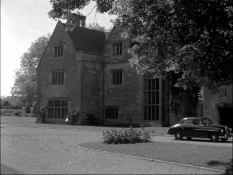runaway lovers edward langley and katharine dowsett press at greatford hall england lincolnshire stamford greatford hall ext lake pan to greatford... - itv late evening bulletin stock videos and b-roll footage