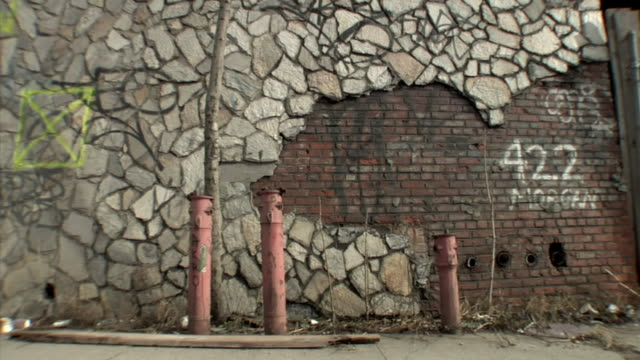 ms rundown brick and stone wall with graffiti / new york city - deterioration stock videos & royalty-free footage
