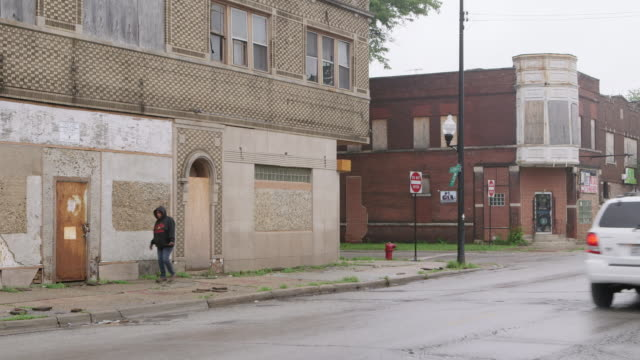 WS Run-down buildings in ghetto day