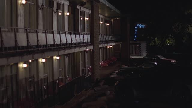 ha rundown hotel exterior at night / toronto, ontario, canada - motel stock videos & royalty-free footage