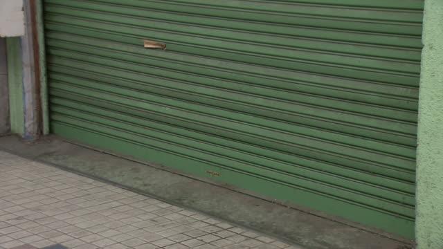 vidéos et rushes de a run-down shopping arcade, ehime, japan - volet