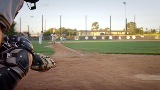 ms slo mo runner at 3rd runs home slides umpire calls safe / riverside, california, united states - baseballmannschaft stock-videos und b-roll-filmmaterial