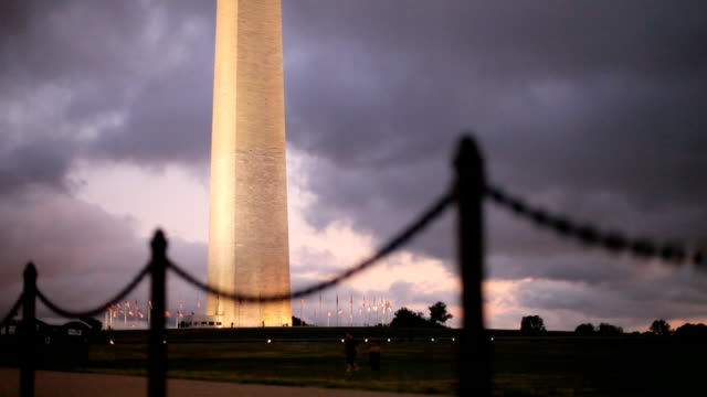 runner by washington monument at sunset - washington monument washington dc stock videos & royalty-free footage