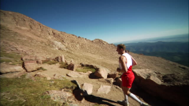 MS TD  Runner goes around on corner  / Colorado Springs/ Pikes Peak,CO,USA