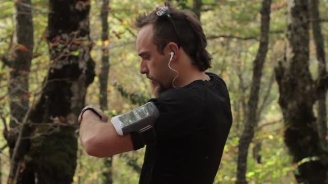 Runner looks his smart watch