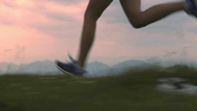 slo mo runner running on the top of a mountain ridge - human foot stock videos and b-roll footage