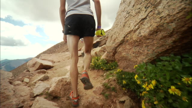 TS WS Runner slowly starting to walk on steep hill during race / Colorado Springs/ Pikes Peak, CO, USA