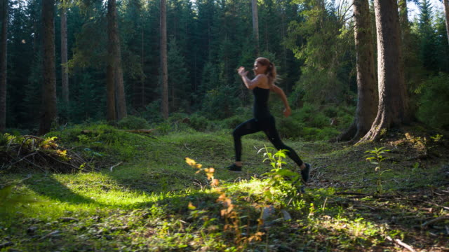 runner sports training in forest - body care and beauty stock videos & royalty-free footage