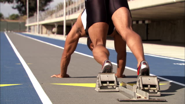 a runner sprints on a track. - track and field athlete stock videos & royalty-free footage
