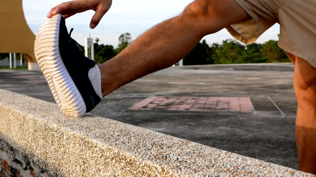 runner stretching legs before jogging - stretching stock videos and b-roll footage