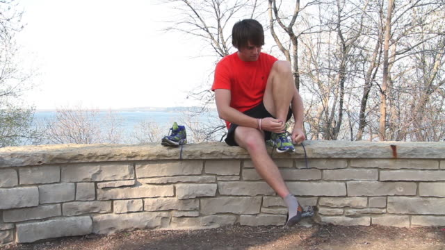 runner tying his shoes - one teenage boy only stock videos & royalty-free footage