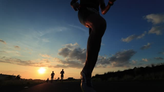 Runners compete at sunset during the IRONMAN World Championship on October 14 2017 in Kailua Kona Hawaii