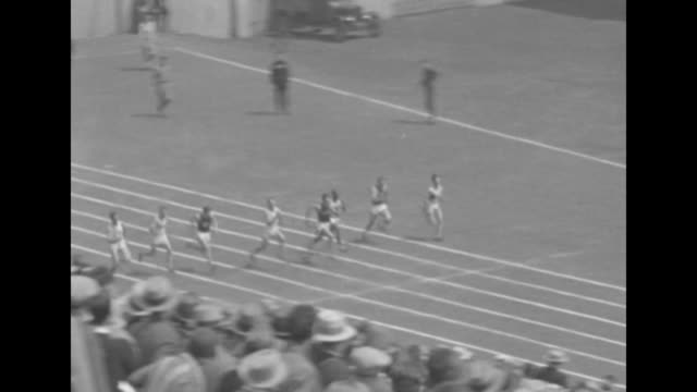 runners competing in 100 yard dash george simpson of ohio state university winning race / close shot of simpson who has just broken world record in... - ohio state university stock videos & royalty-free footage