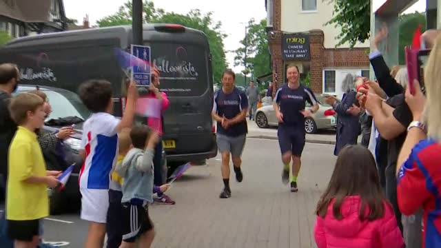 runners complete 'palace to paris' charity run in aid of leukaemia research; england: london: orpington: ext jordan smith and lee roberts complete... - competition stock videos & royalty-free footage