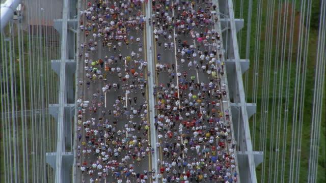 runners cross the verrazano narrows bridge during the new york city marathon. - 2016 stock videos and b-roll footage