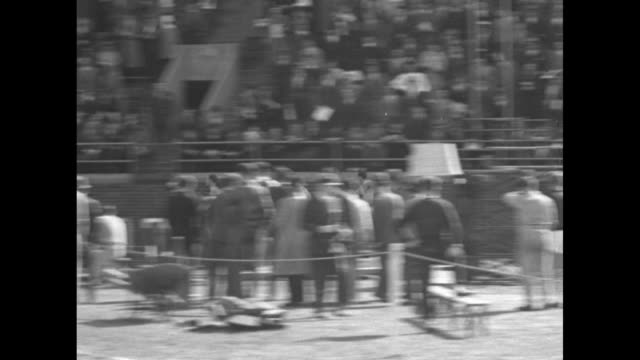 right runners doing the quarter mile relay along track at university of pennsylvania's franklin field crowd cheers in stands in background / cu hands... - new york university stock videos & royalty-free footage